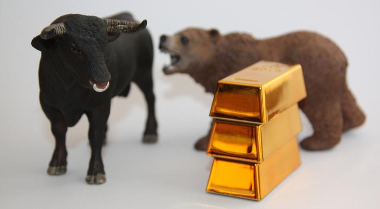 prix de l'or illustration figurines ours et taureau